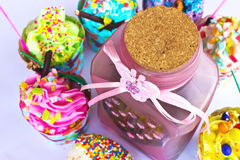Colorful of Cupcake with bottle Stock Photos