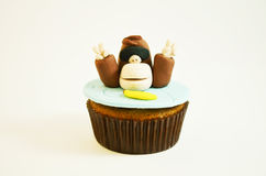 Colorful  cupcake with  a monkey figure. Colorful funny cupcake with  a monkey figure Stock Image