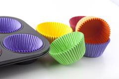 Colorful Cupcake Papers. And muffin pan ready for baking Royalty Free Stock Photo