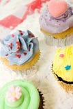 Colorful cupcakes Stock Photos