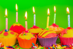 Colorful cupcakes with candles Royalty Free Stock Photo