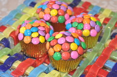 Colorful cupcakes with candy topping Stock Photo