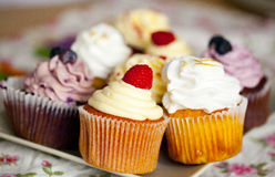 Colorful cupcakes with cream and fresh berries Stock Photo