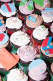 Colorful cupcakes. Cupcake with colorful figures made of fondant Royalty Free Stock Photography