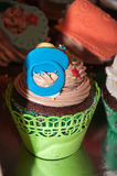 Colorful cupcakes. Cupcake with colorful figures made of fondant Stock Images