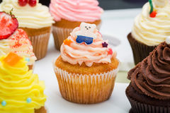 Colorful cupcakes with different Tastes. Cupcake decorated candy bear. beautifull cakes on white table. Close up Royalty Free Stock Image