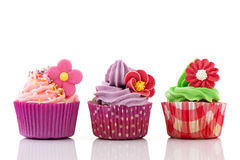 Colorful cupcakes with flowers Royalty Free Stock Photography