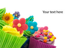 Colorful cupcakes with flowers Royalty Free Stock Photos