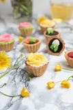 Colorful cupcakes on grey marble table Royalty Free Stock Images