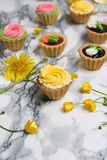 Colorful cupcakes on grey marble table Stock Photo