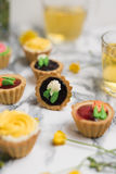 Colorful cupcakes on grey marble table Stock Photography