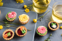 Colorful cupcakes on grey plate and table Stock Photo