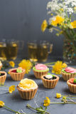 Colorful cupcakes on grey plate and table Royalty Free Stock Image