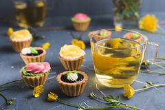Colorful cupcakes on grey plate and table Stock Images