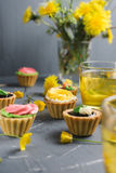 Colorful cupcakes on grey plate and table Royalty Free Stock Photography