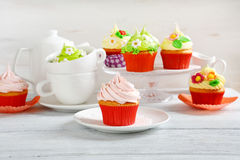 Colorful cupcakes on rustic Easter table Royalty Free Stock Image