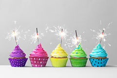 Colorful cupcakes with sparklers Royalty Free Stock Image