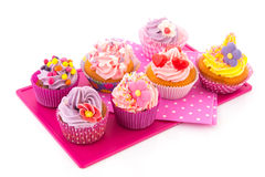 Colorful cupcakes on tray Stock Photo