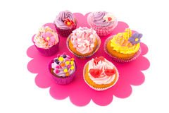 Colorful cupcakes on tray Stock Image