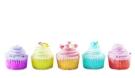 Colorful cupcakes on a white background Stock Photos