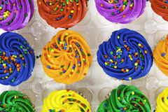Colorful cupcakes on white background Stock Photography