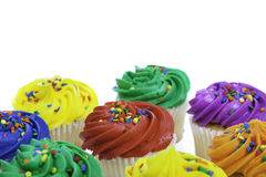 Colorful cupcakes on white background royalty free stock image