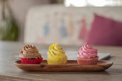 Colorful mix delicious fresh cupcakes stock image
