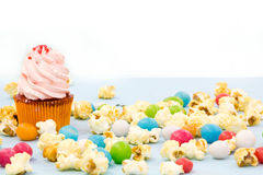 Colorful cupcakes on a wooden background Stock Photos