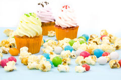 Colorful cupcakes on a wooden background Stock Image