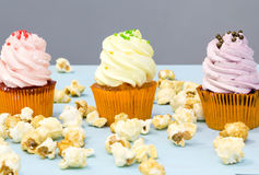 Colorful cupcakes on a wooden background Stock Photography