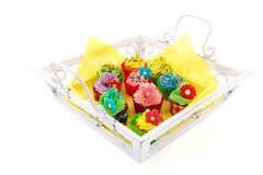 Colorful cupcakes on wooden tray Stock Images
