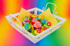 Colorful cupcakes on wooden tray Royalty Free Stock Images