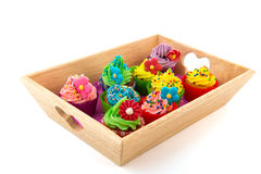 Colorful cupcakes on wooden tray Royalty Free Stock Photo