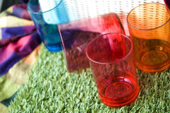 Colorful cups on grass Royalty Free Stock Photography