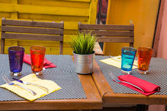 Colorful Cups and Napkins on Table Stock Photo