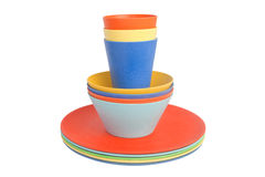 Colorful cups on piled plates Royalty Free Stock Image