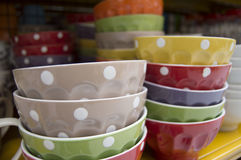 Colorful cups with pois. Sale of colorful cups with pois Stock Images
