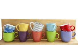 Colorful cups in a row Stock Photo