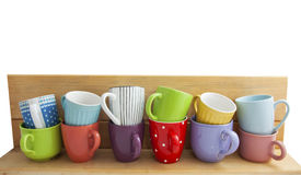 Colorful cups in a row Royalty Free Stock Images