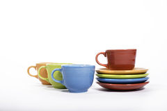 Colorful Cups and saucers. Fiesta colored cups and saucers Stock Photography