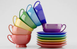 Colorful cups and saucers. On white background Stock Photos