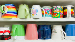 Colorful Cups On The Shelf Stock Photo