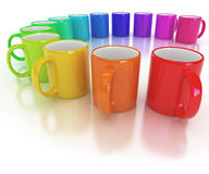 Colorful cups on the white Stock Photos