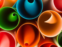 Colorful curled paper background Stock Images