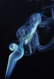 Colorful curls of smoke rise up Royalty Free Stock Images