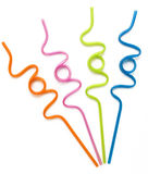 Colorful Curly Drinking Straws. Orange, pink, lime and blue colorful curly drinking straws against a white background Royalty Free Stock Photography
