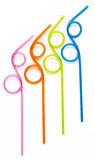 Colorful Curly Drinking Straws. Orange, pink, lime and blue colorful curly drinking straws against a white background Royalty Free Stock Photos