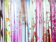 Colorful curtain samples hanging display in a retail shop Royalty Free Stock Photography