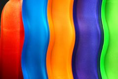 Colorful curves. Row of colorful curvy glasses. Suited for teamwork, harmony, agreement, accord, concord, unity,etc. layout royalty free stock photo
