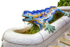 Park Guell by architect Gaudi in a summer day in Barcelona, Spain. Element of a fountain - a lizard of colored mosaic, on royalty free stock images